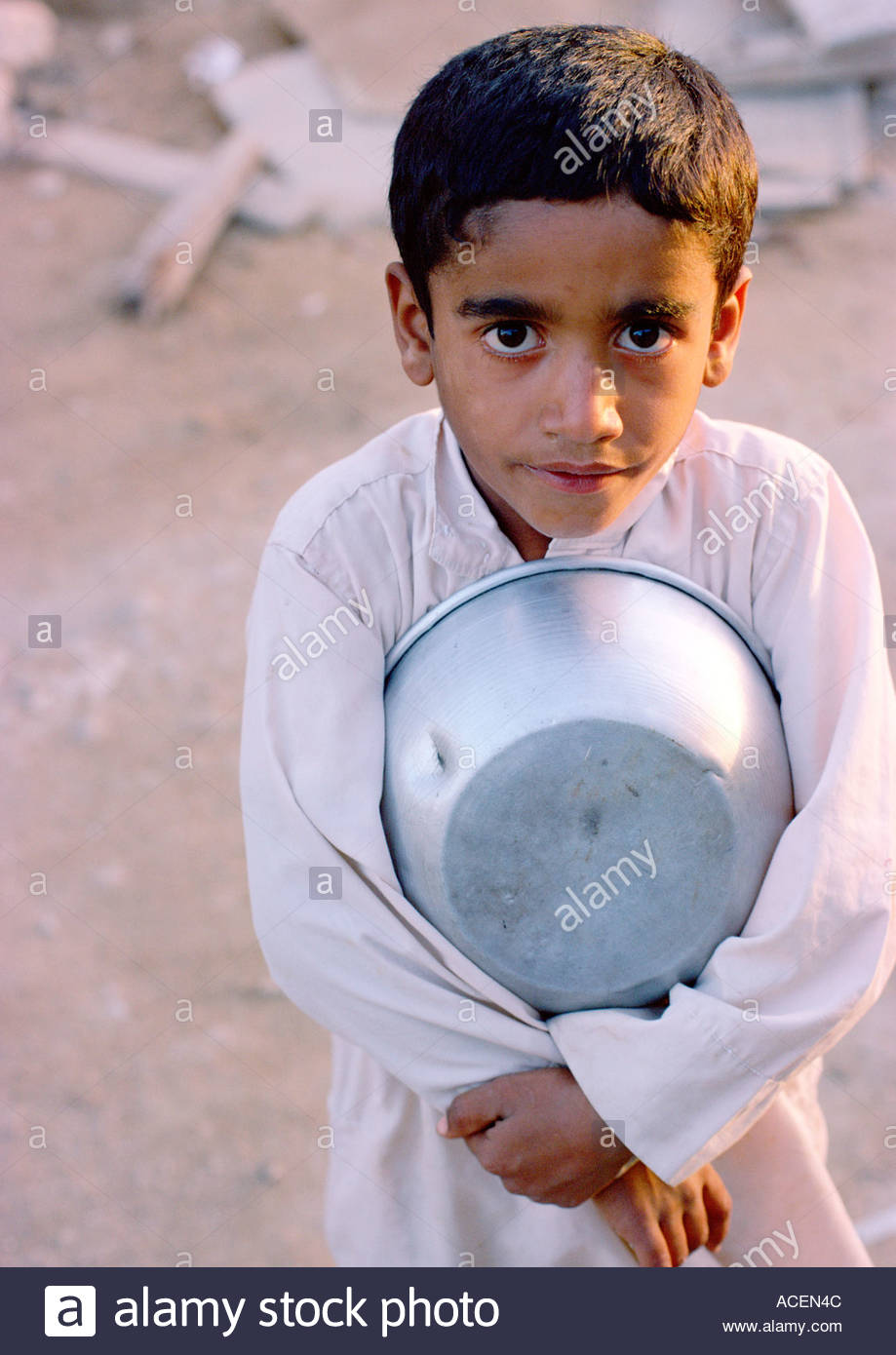 [Image: small-hungry-arab-boy-clutches-his-food-dish-ACEN4C.jpg]
