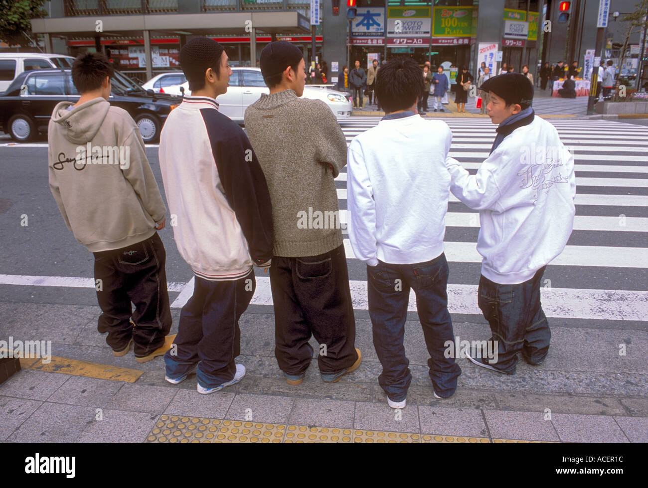 Group of Kyoto hip-hop boys standing on street wearing over-sized baggy clothes trying to be cool Stock Photo