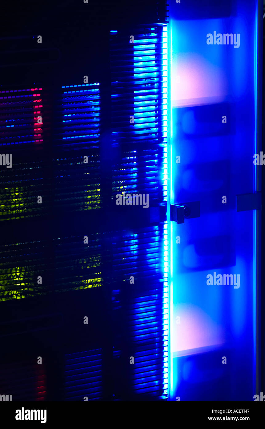 Neon glow from a rack mounted data network server at night Stock ...