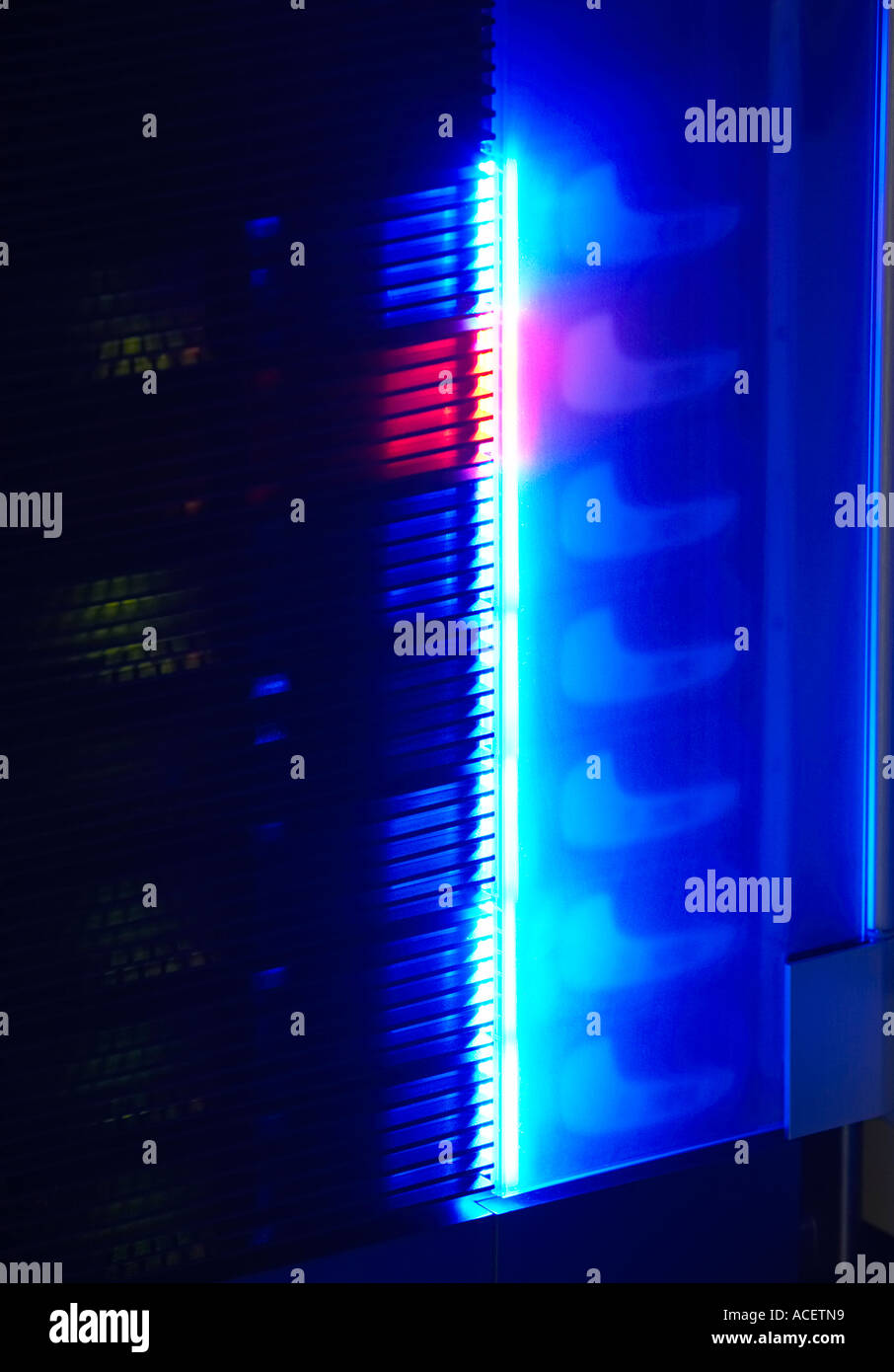 neon glow from a rack mounted network server at night stock photo