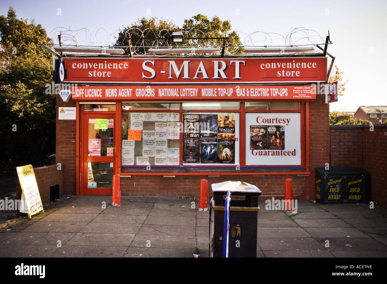 Inner city local corner shop convenience store with added security UK - Stock Image