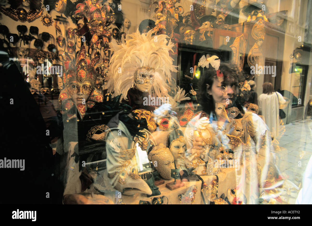 Reflections in window mask shop in Venice Italy - Stock Image