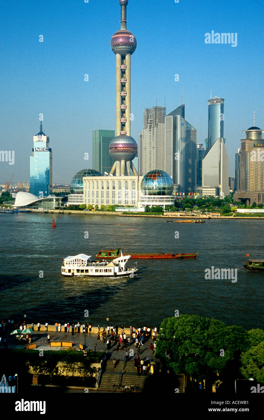 Shanghai China Pudong skyline including Orient Pearl TV Tower across Huangpu River from The Bund waterfront promenade  - Stock Image