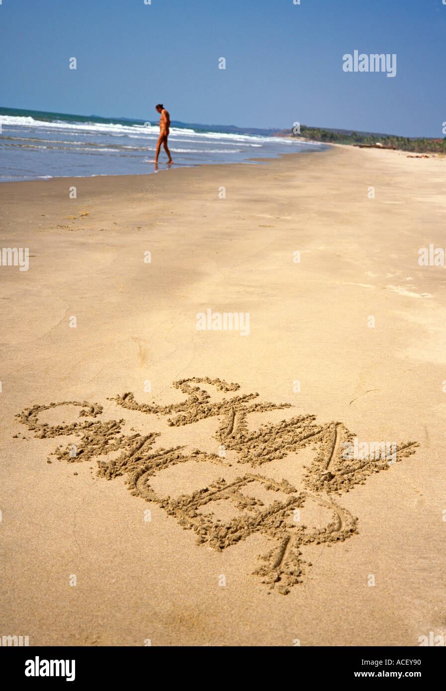 India Goa Skin Cancer in sand with sunbather - Stock Image