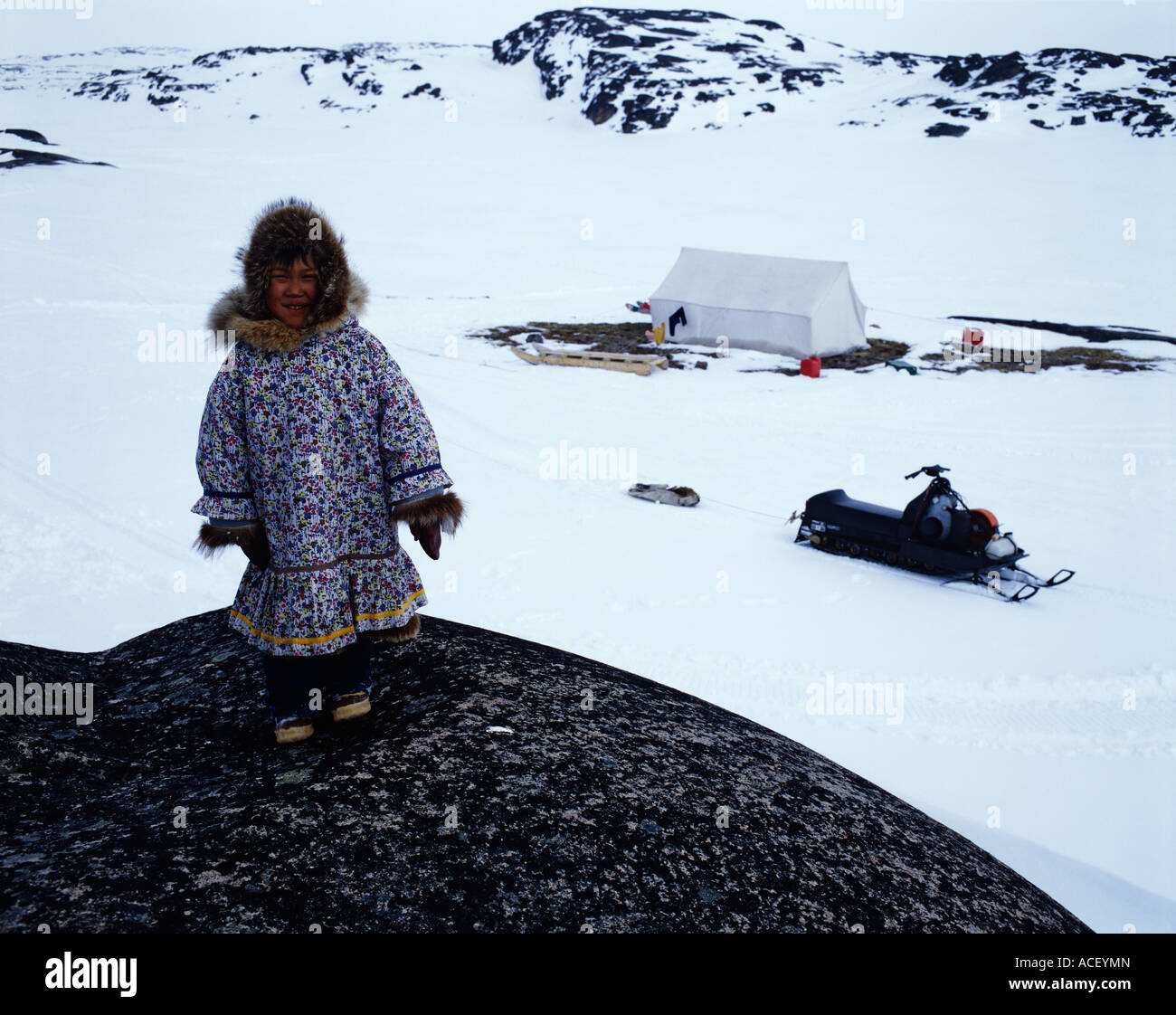 Inuit girl snowmobile and tent - Stock Image