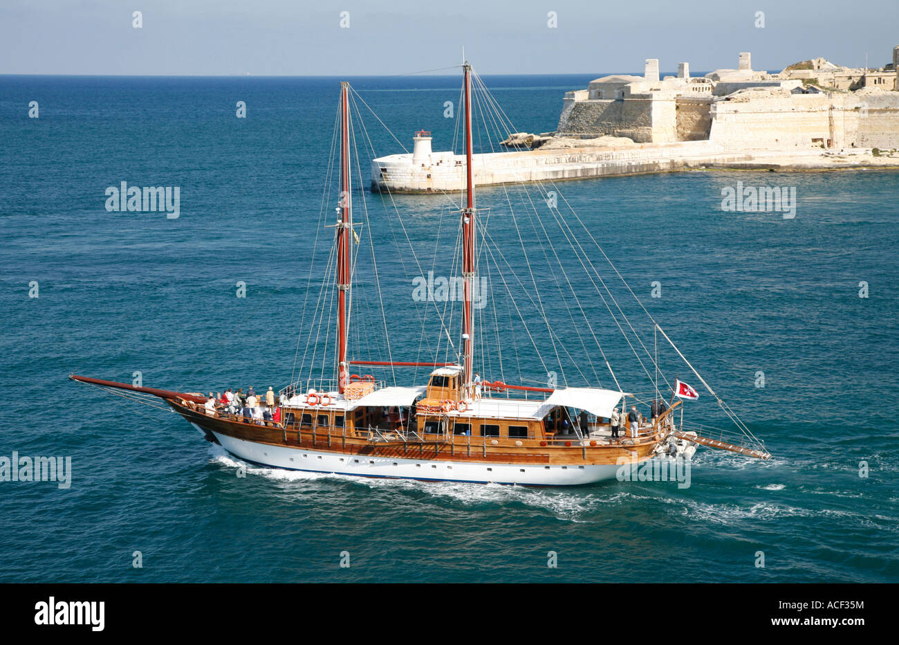 Twin masted sailing boat exiting Grand Harbour, Valletta, Malta Stock Photo