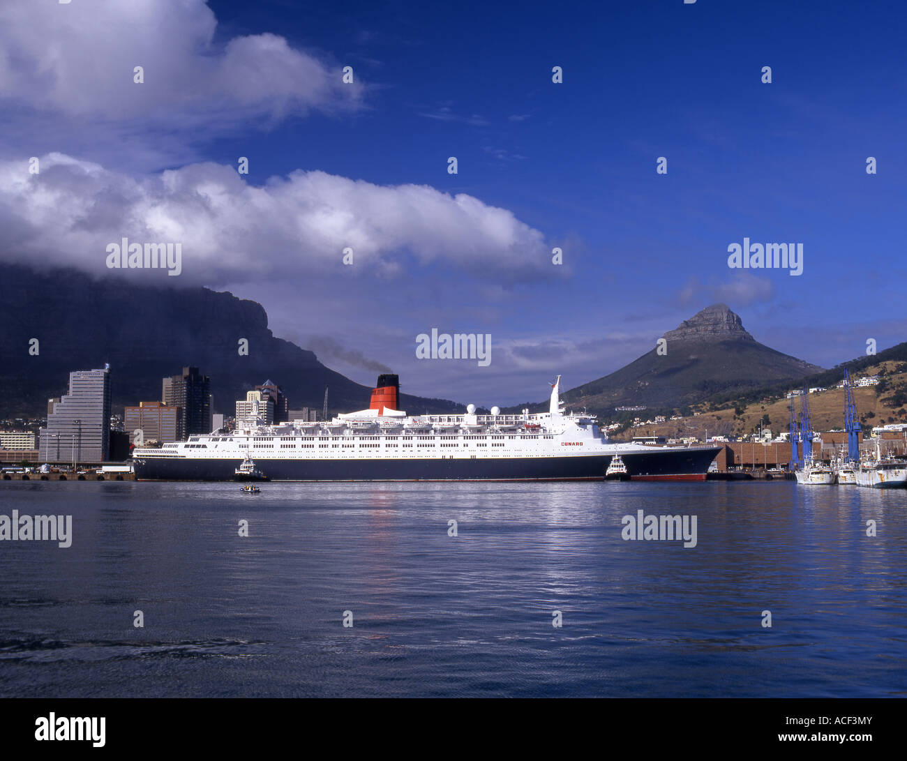 The Queen Elizabeth 2 (QE2) luxury ocean liner moored in Cape Town Harbour Cape Peninsula, Western Cape; South Africa - Stock Image