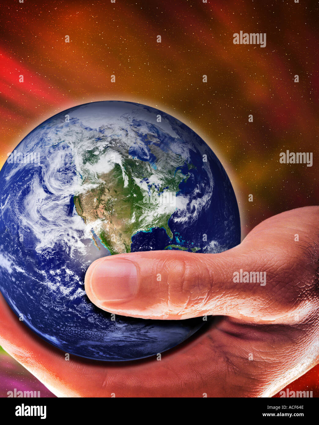 A special effect shot of a hand holding the Earth in space - Stock Image