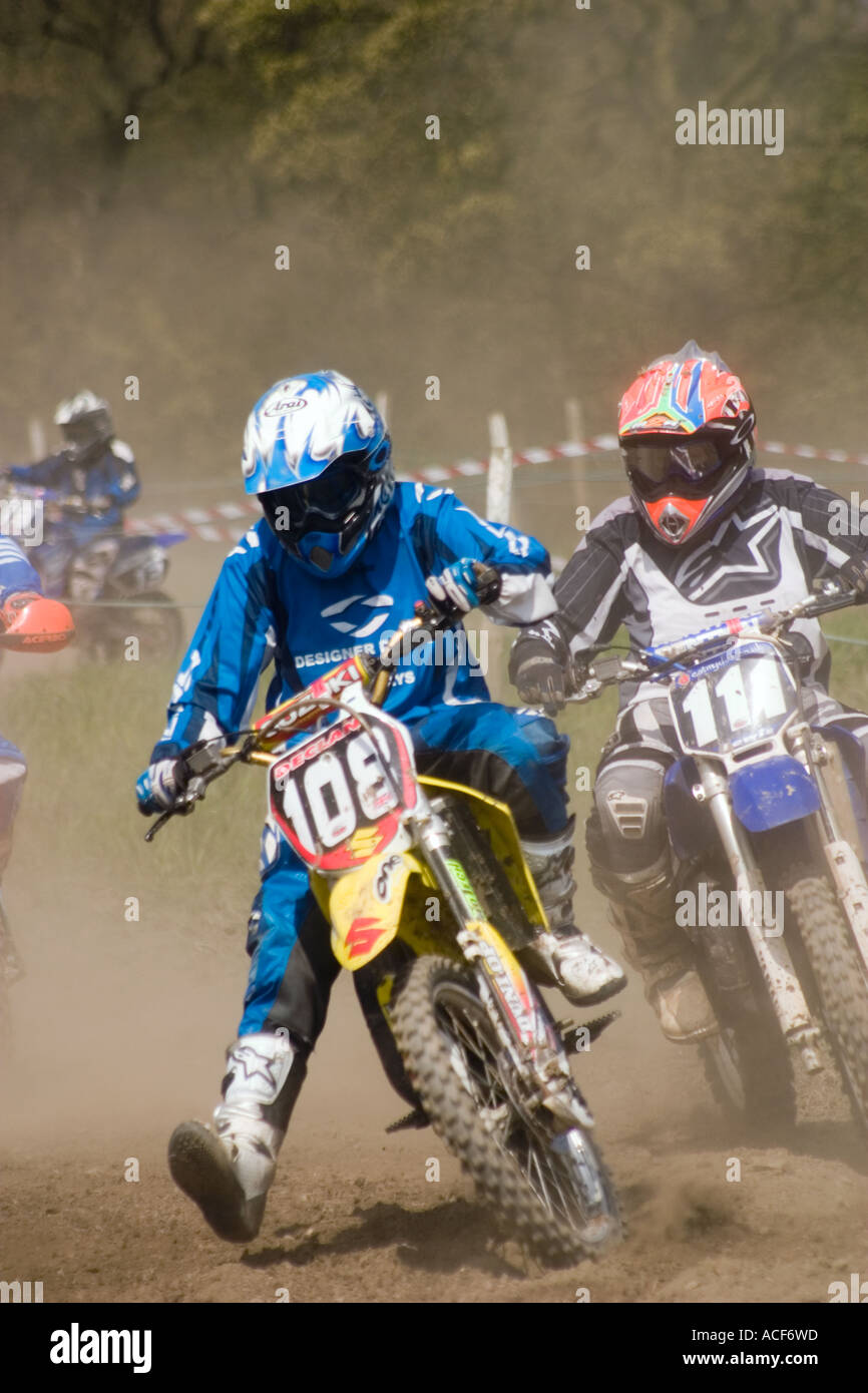 Motocross riders cornering during race Stock Photo