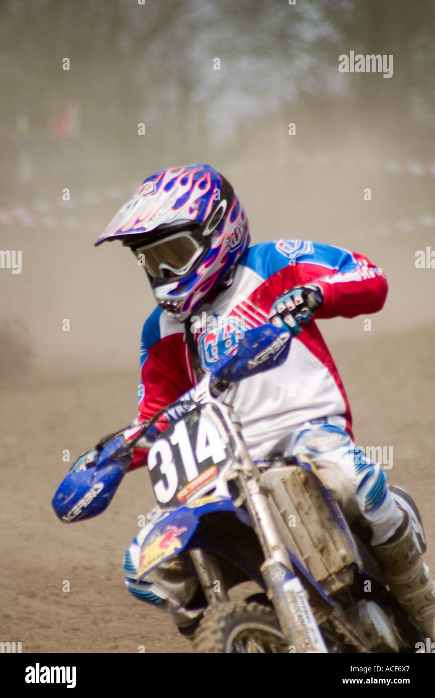 Motocross riders cornering during race - Stock Image