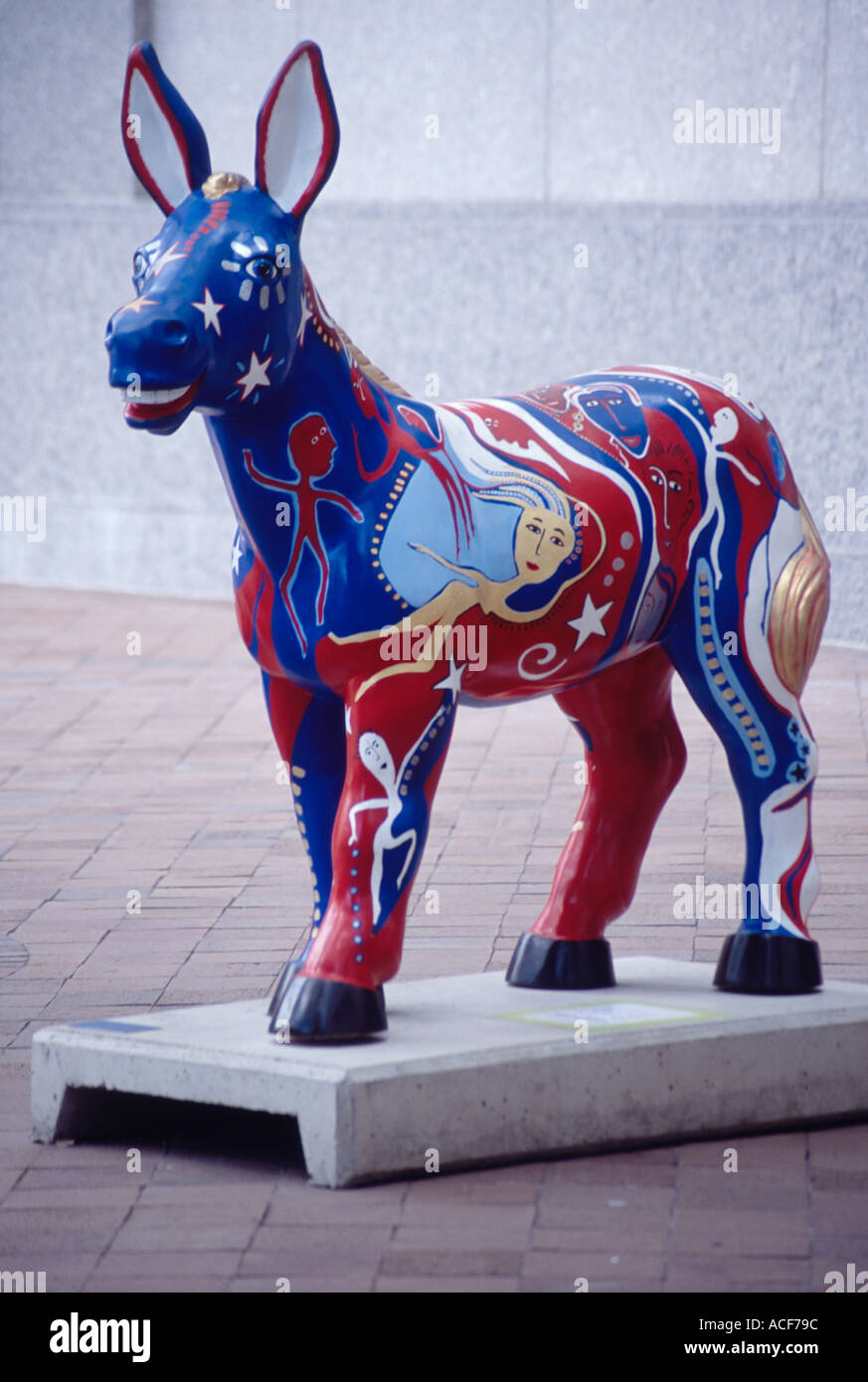 Imaginatively painted statue of a Democratic donkey part of the Party Animals art series on Washington DC sidewalks - Stock Image