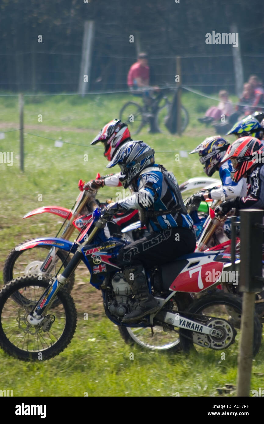 Bikes and riders setting off at start of Motocross race - Stock Image