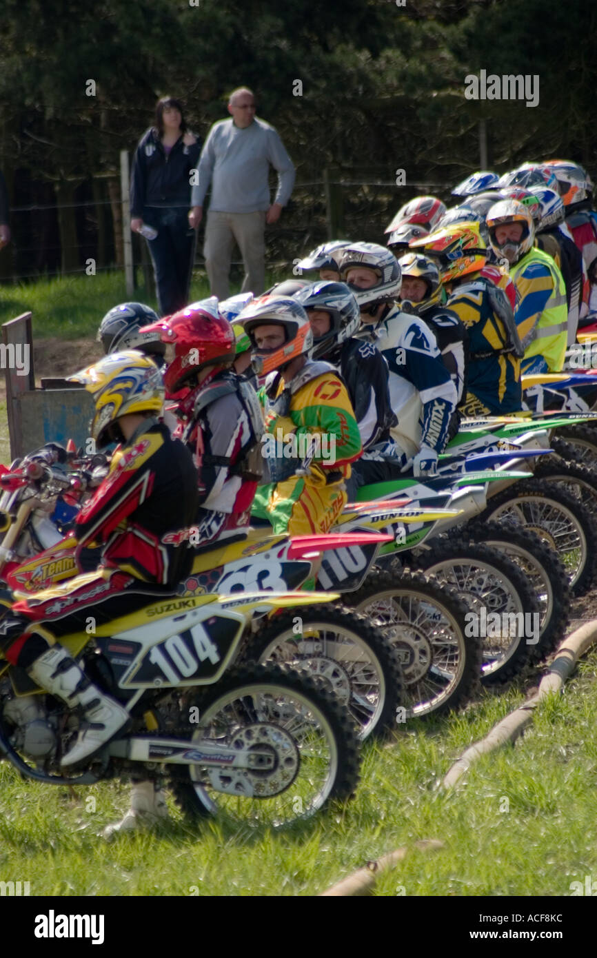 Bikes and riders lined up waiting for start of Motocross race - Stock Image