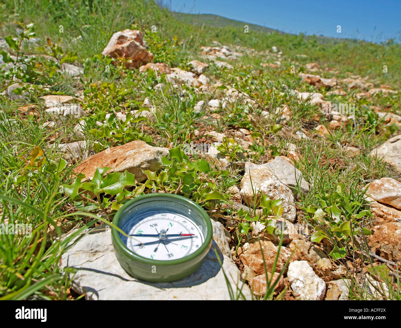 compass on the ground tracking hiking in the nature controlling the orientation with a compass - Stock Image