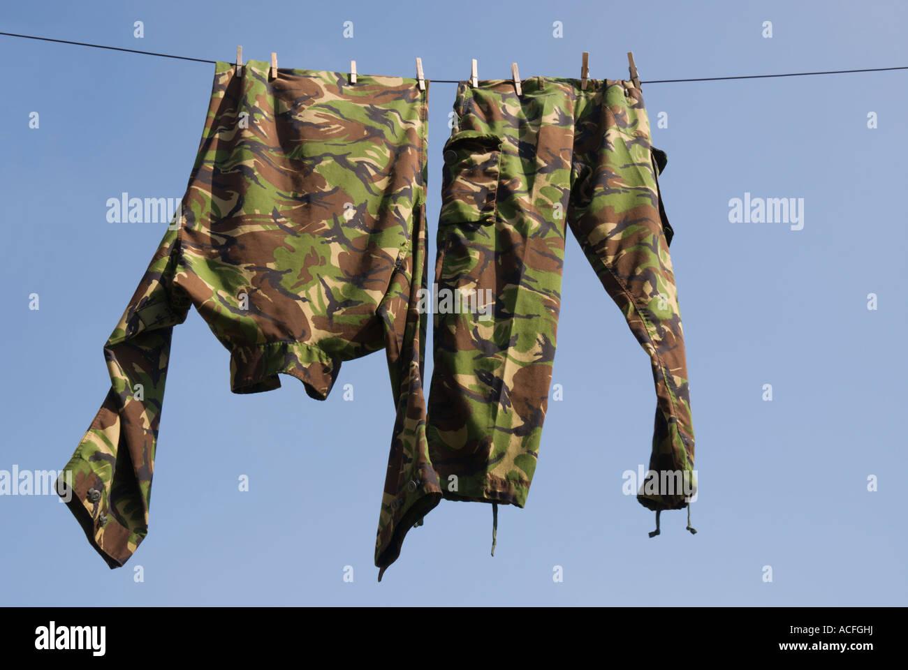 Modern British Army clothing hanging on a washing line - Stock Image