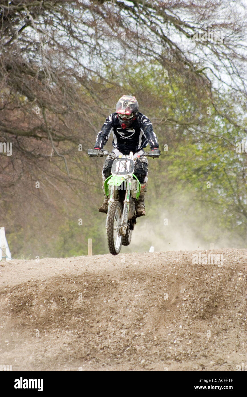 Junior riders at Motocross event during race - Stock Image