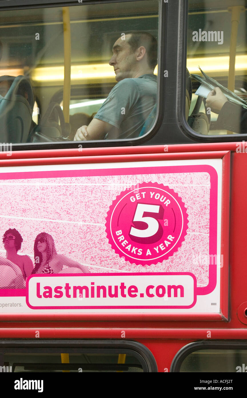 An advert on a london Bus persuading the public to take 5 holidays a year not very sustainable if they are all flying Stock Photo