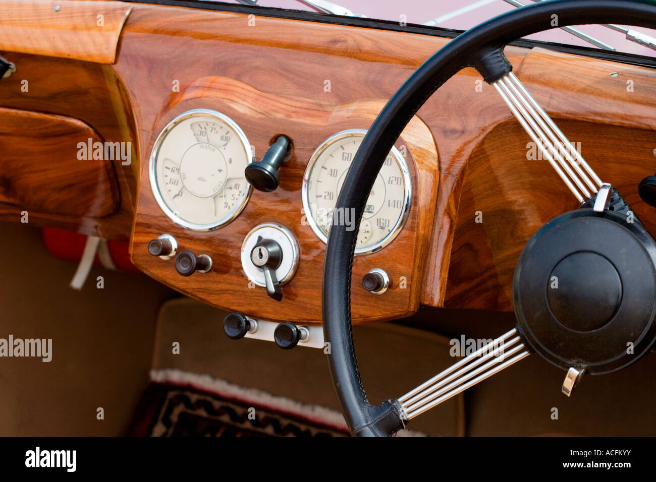 Wooden dashboard in a old car - Stock Image