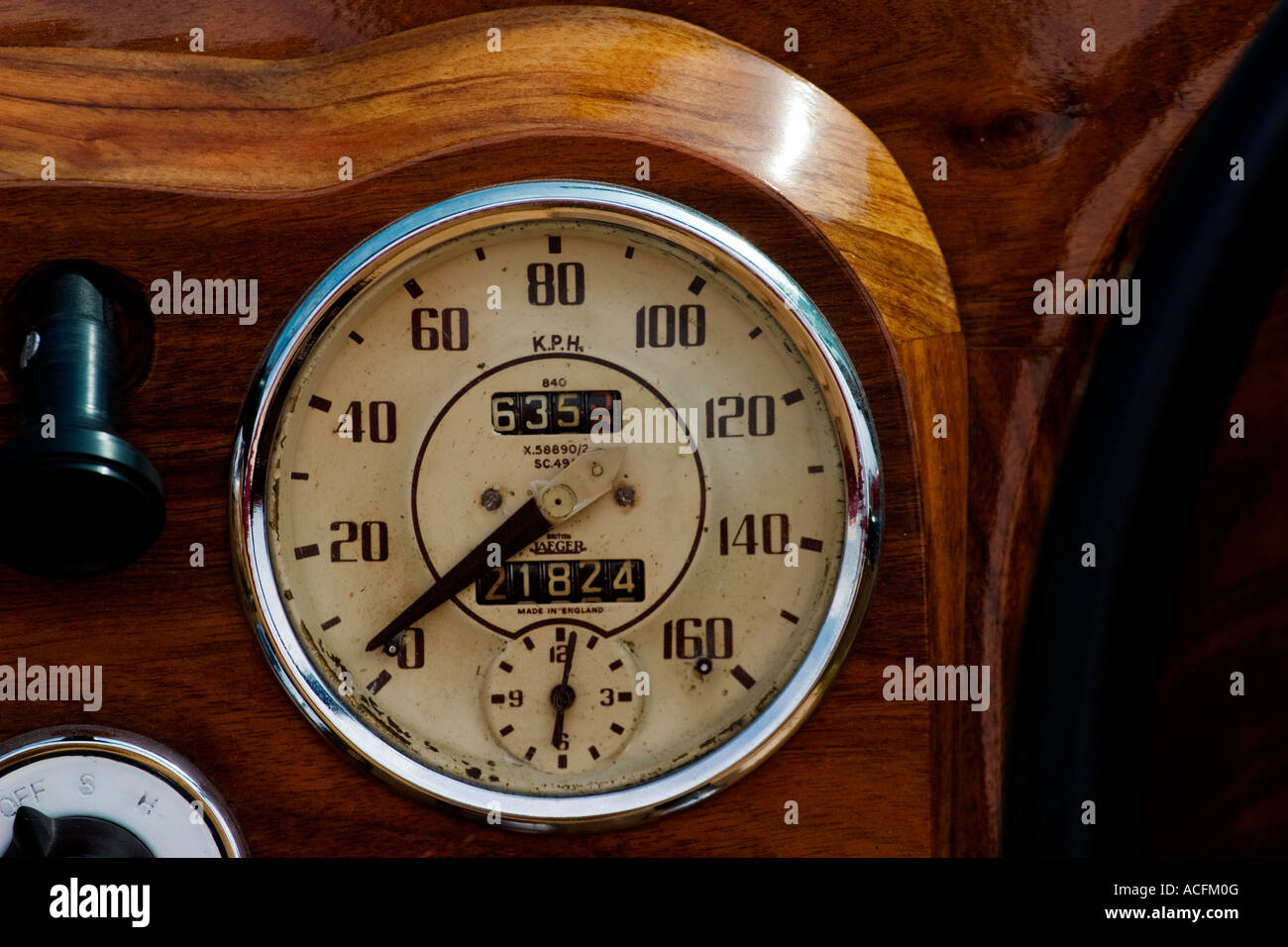 Speedometer in a wooden dashboard - Stock Image