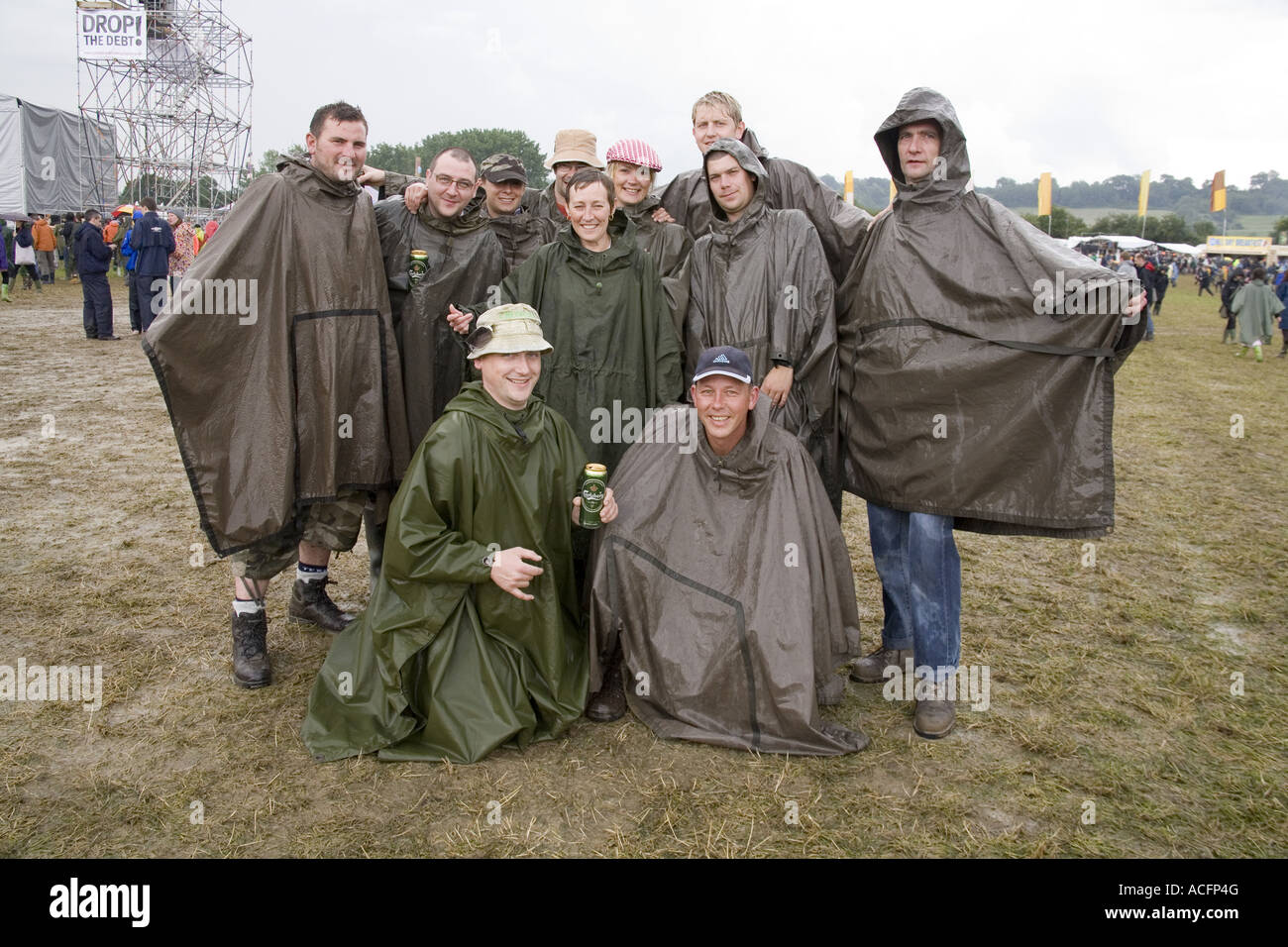 Crowd of people in waterproof ponchos to stay out of the rain. At the Glastonbury festival 2007. - Stock Image