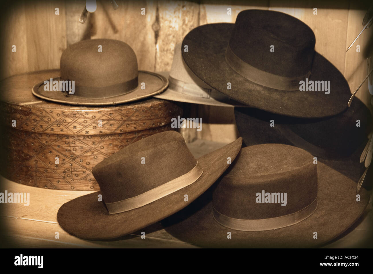 Selection of old fashioned hats in sepia tones - Stock Image