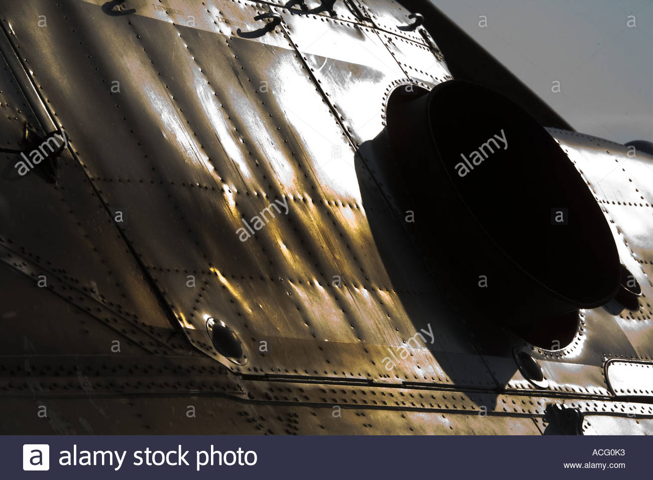 Sheet metal on helicopter airframe shining in this extreme contrasty image - Stock Image
