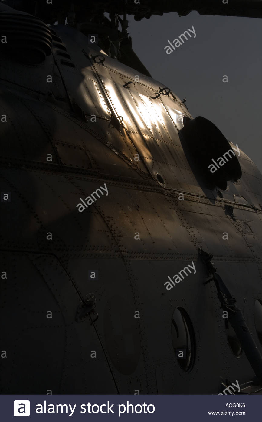 Helicopter airframe shining in this extreme contrasty image - Stock Image