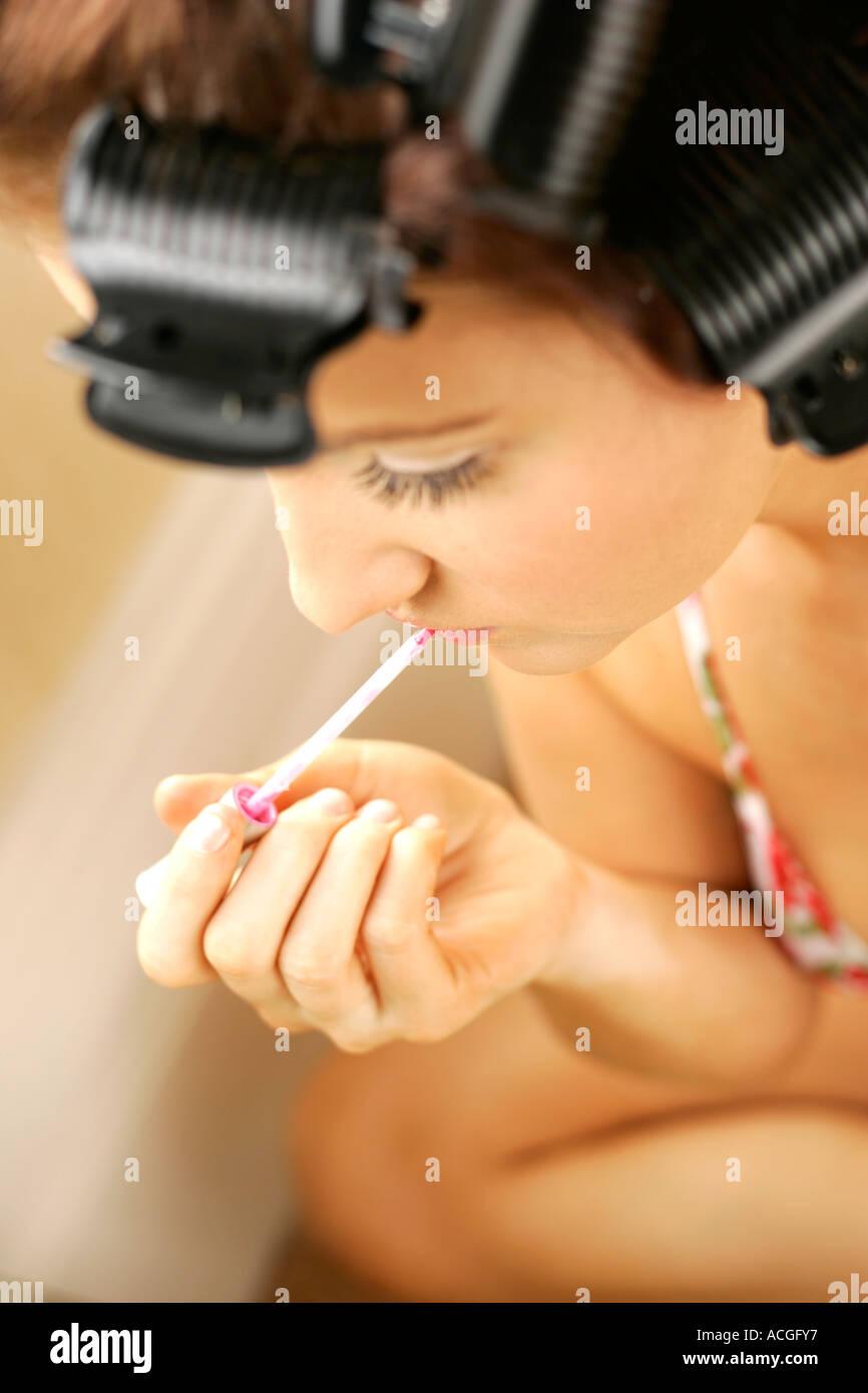 Young girl applying make up - Stock Image