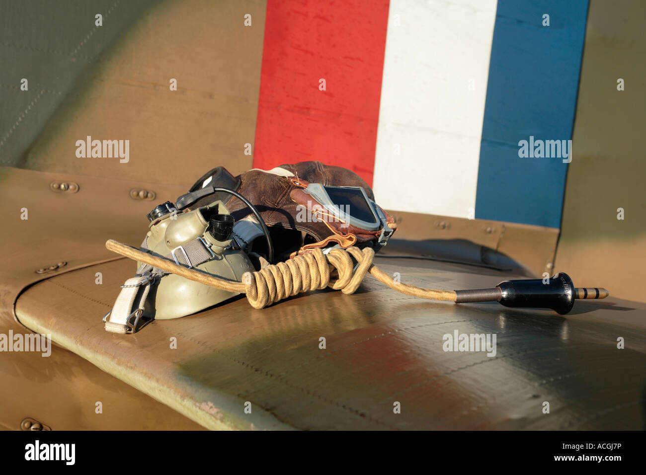 Old flying helmet and intercom on tailplane of a Hawker Hurricane - Stock Image