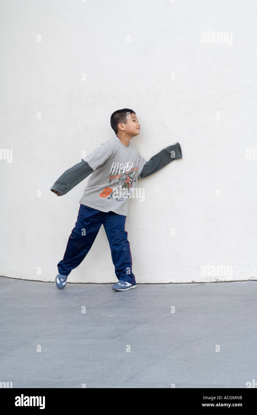 Boy plays hide and seek on front off MACBA Contemporary Art Museum of Barcelona Barcelona Catalunya Spain Europe - Stock Image