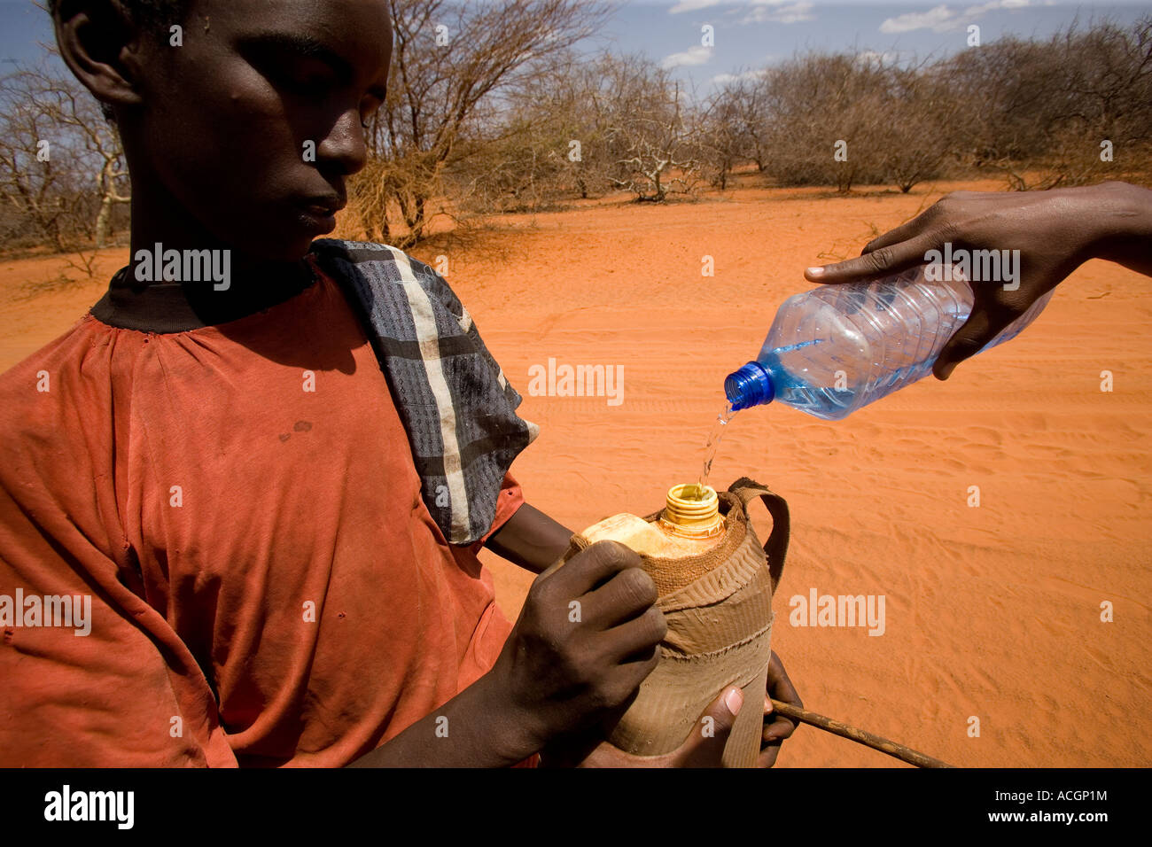 NORTH EAST KENYA 6th MARCH 2006 A nomad boy gets water from a passing driver during the worst drought in 20 years - Stock Image