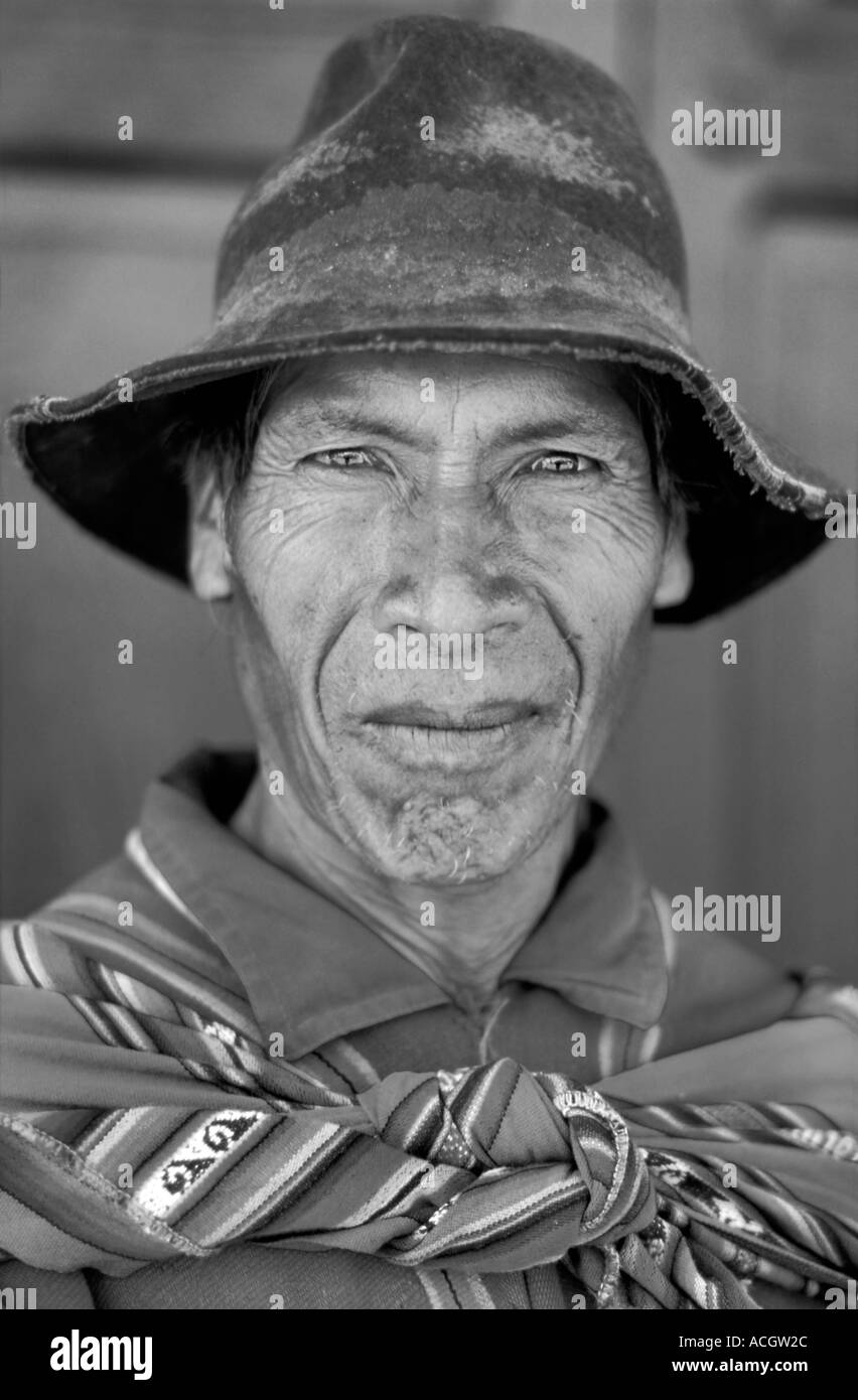 Quechua speaking man in distinctive hand woven tribal costume Tarabuco is famous for its Sunday market Bolivia South America - Stock Image