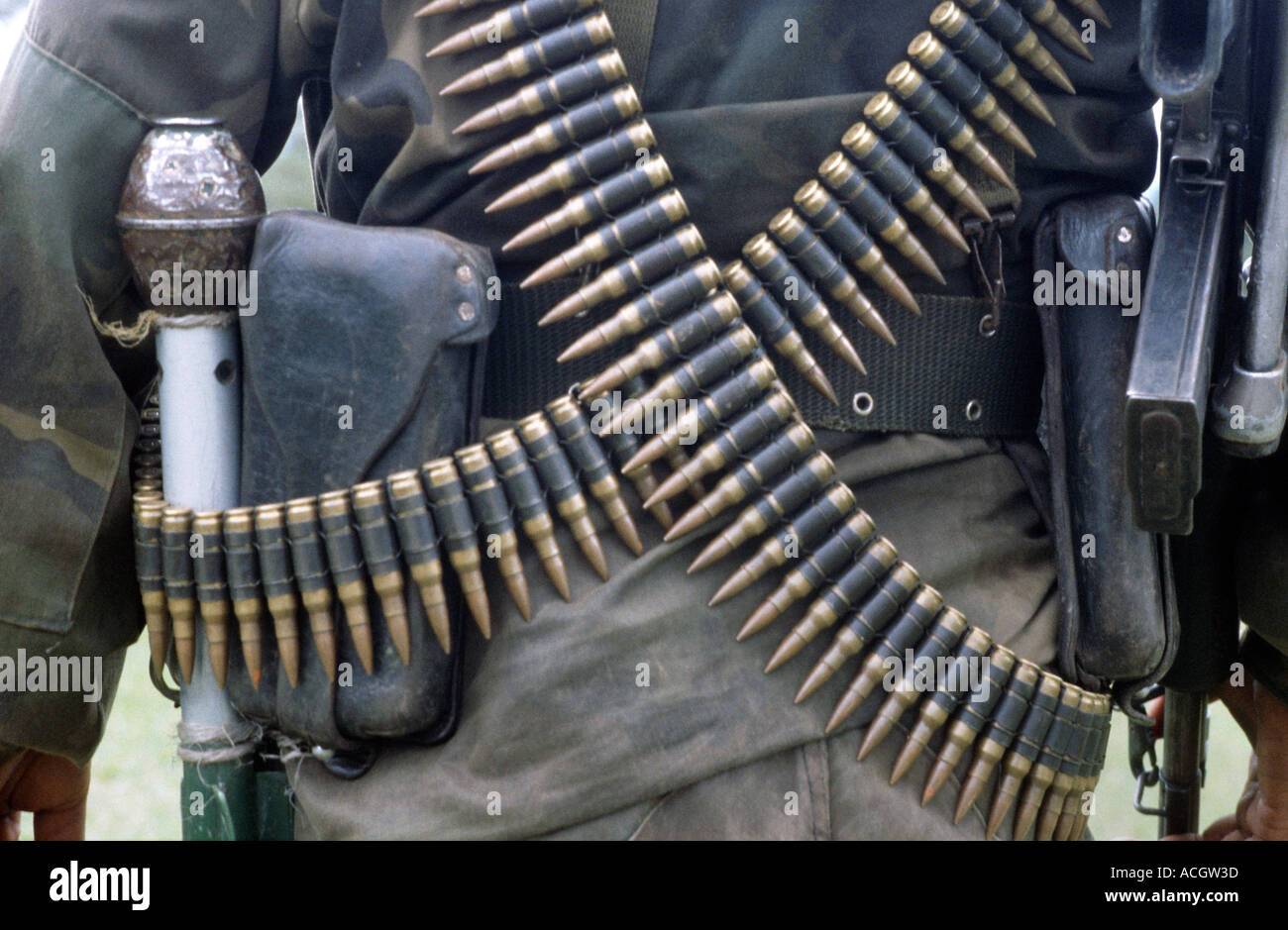 Close up of ammunition gun and grenade held by a Colombian soldier San Agustin nr Popayan Colombia - Stock Image