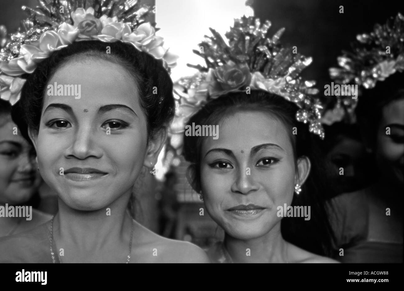 Young smiling brightly dressed Balinese dancers Photographed whilst waiting to perform Ubud Indonesia Stock Photo
