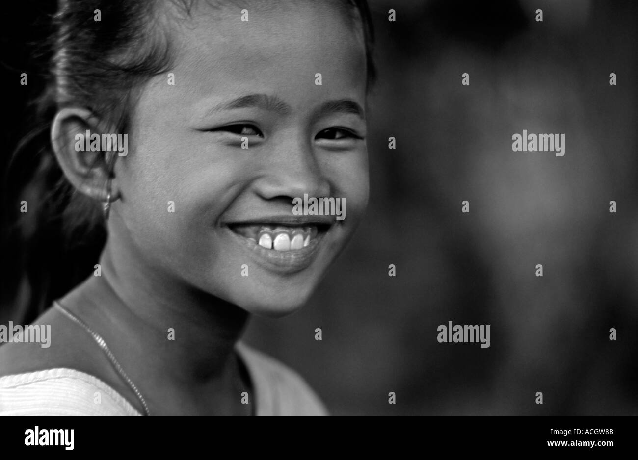 Balinese girl from the village of Amed at a community event Bali Indonesia Black and white image - Stock Image