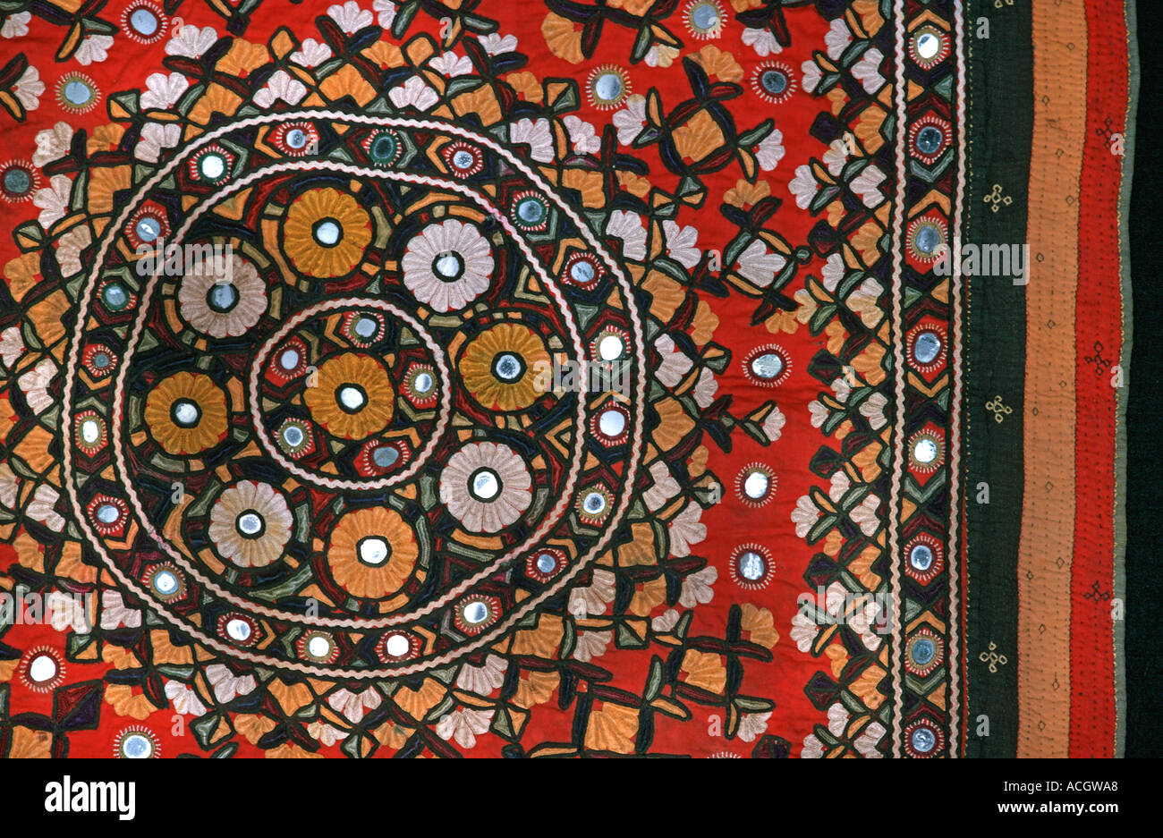 Woven and embroidered textile with applique mirrors from the Indian Subcontinent From Pakistan or from Gurta or Rajahstan India - Stock Image