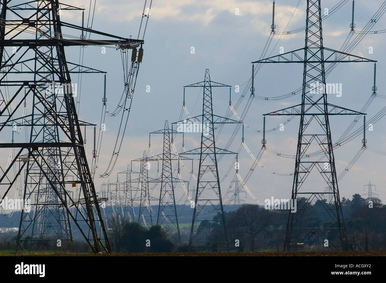 National Grid Electricity Pylons carrying power from Sizewell A and B nuclear power stations off the Suffolk coast, Suffolk, UK - Stock Image