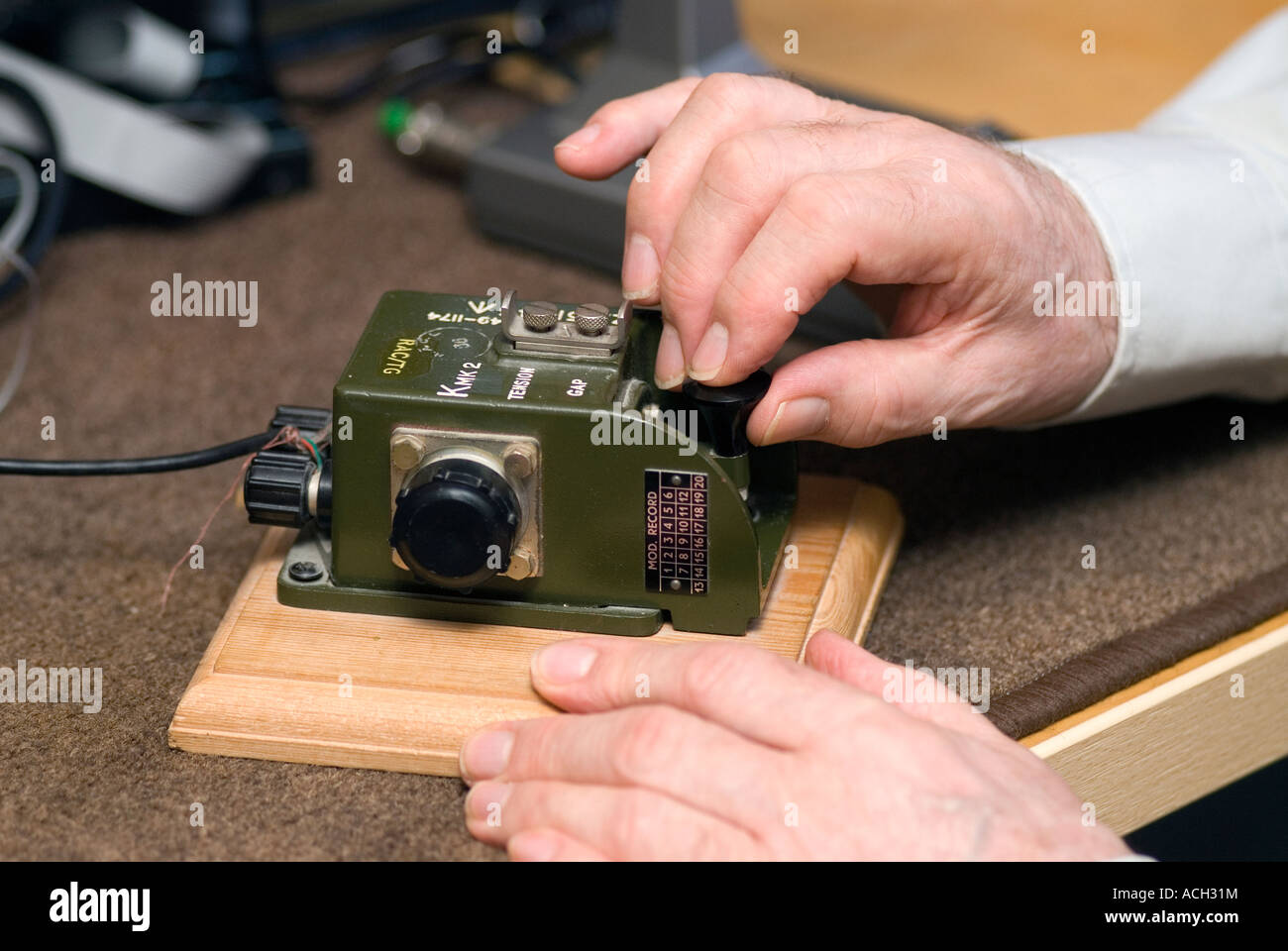 Blind man indulging his hobby for amateur radio and using morse code device, London, UK. - Stock Image