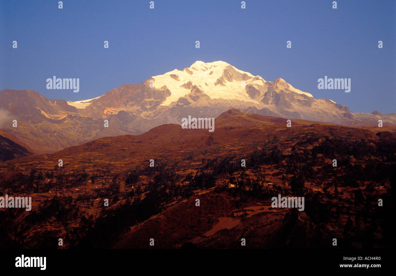 Snow capped Mount Illampu with the altitude of 6700 meters lit by the sunset above Sorata Bolivia - Stock Image