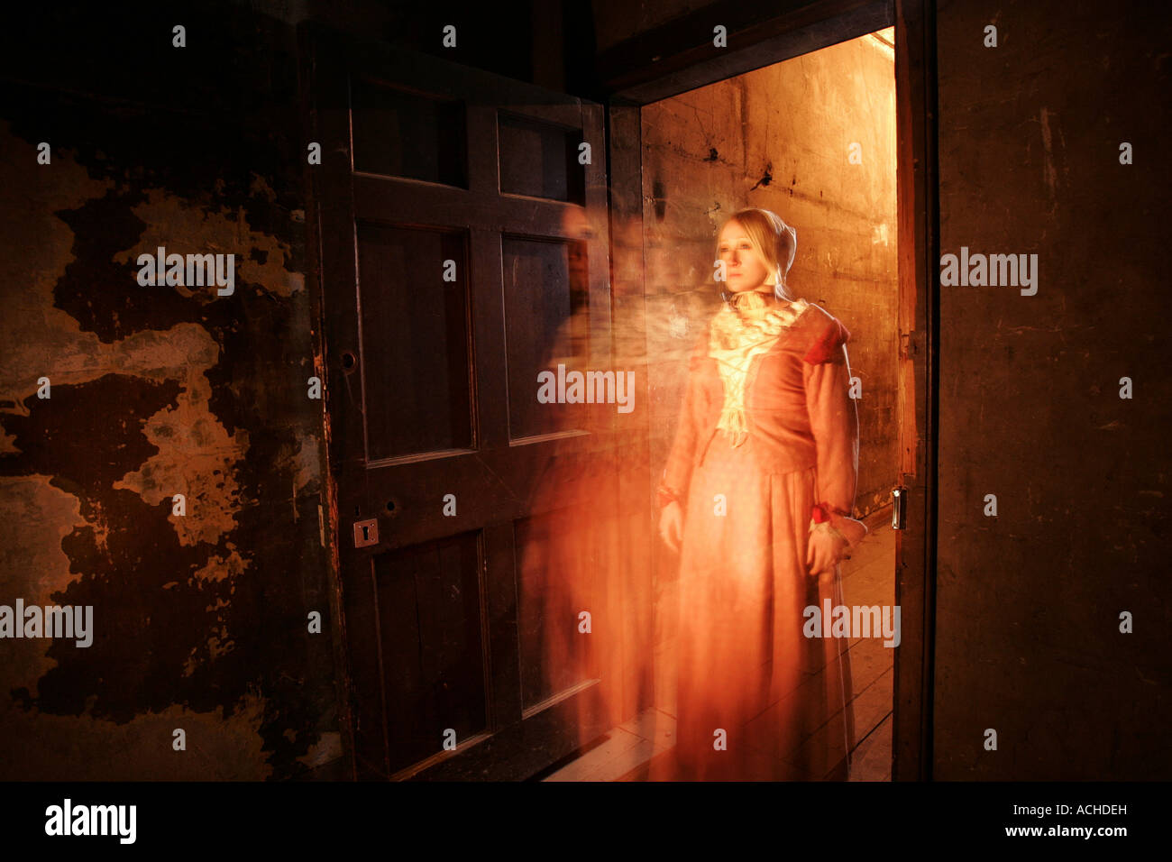The ghostly figure of a girl standing in a doorway in the Real Mary King's Close, a tourist attraction in Edinburgh, - Stock Image