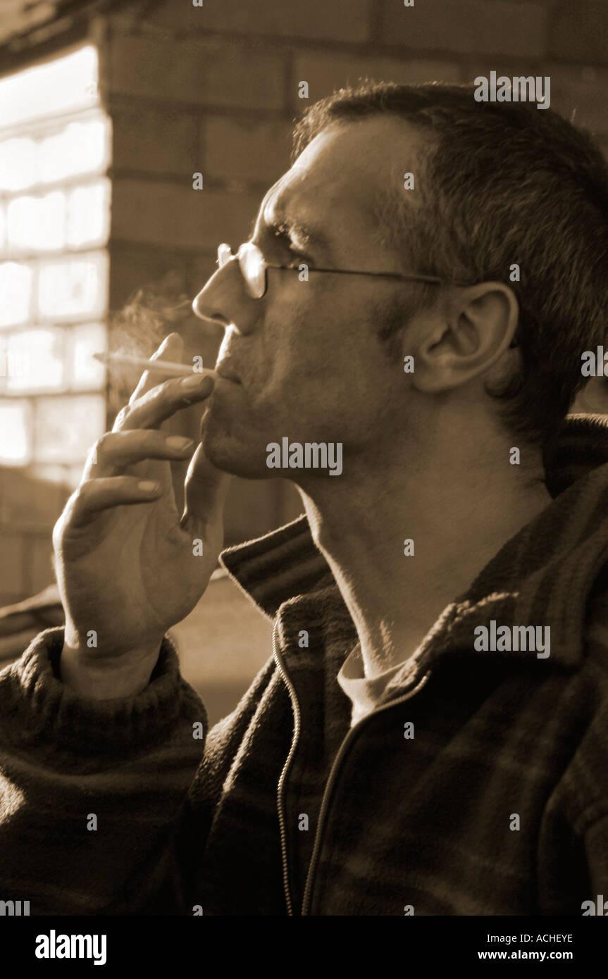Man Smoking - Stock Image