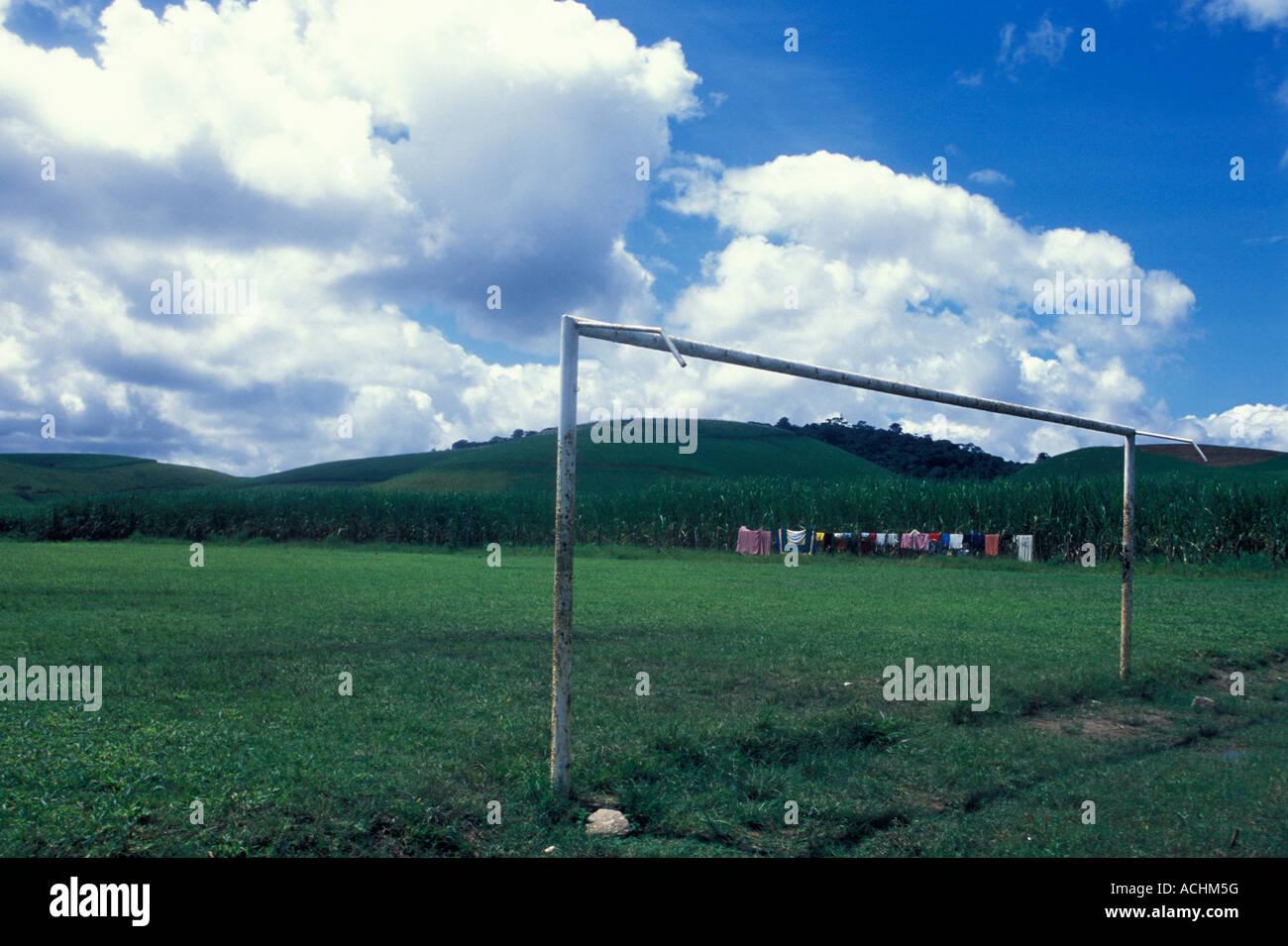 Clothes drying at soccer field besides sugarcane plantation Pernambuco State Brazil - Stock Image