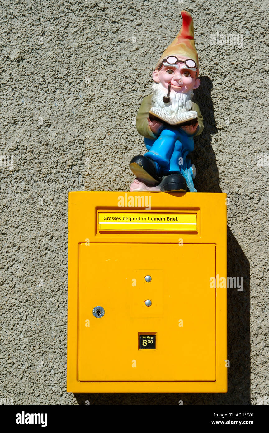 Gnome and letterbox with slogan 'Great things begin with a letter' - Stock Image