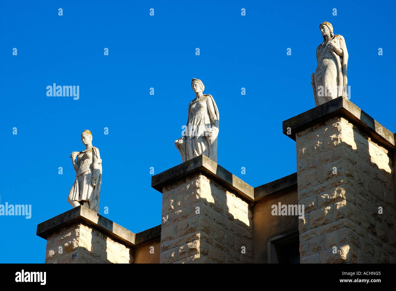 Sculptures on the postal and telecommunications building Ragusa Italy - Stock Image