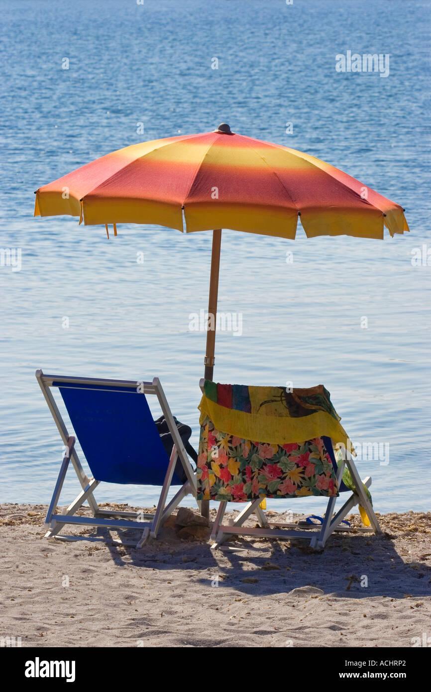 Sunshade an loungers on the beach, Sardinia, Italy - Stock Image
