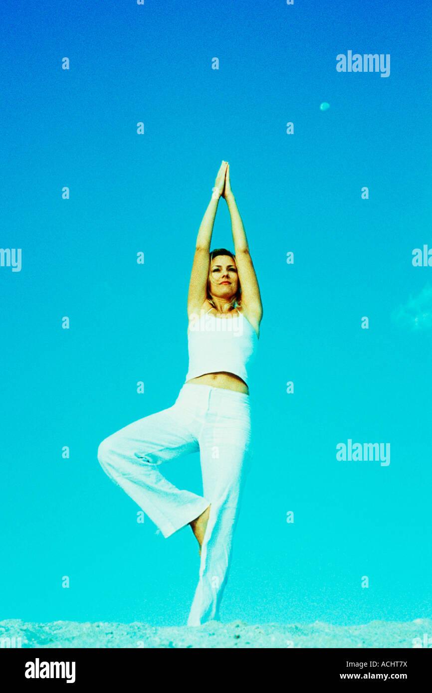 Woman doing gymnastic movements - Stock Image