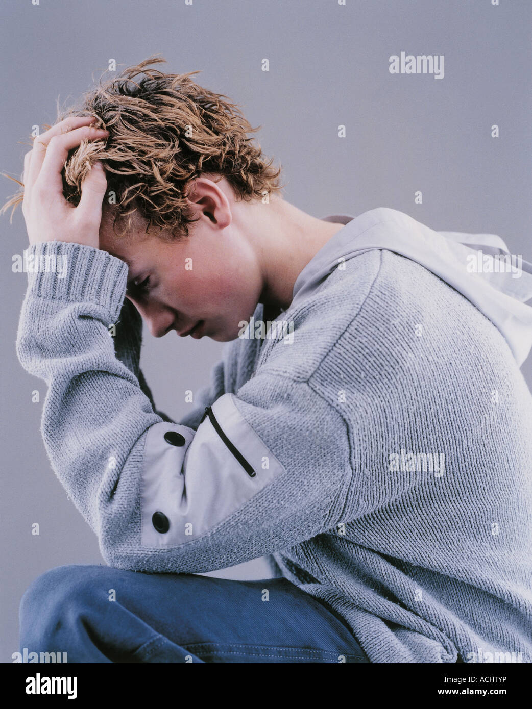Portrait sad teenager profile hands on head Stock Photo