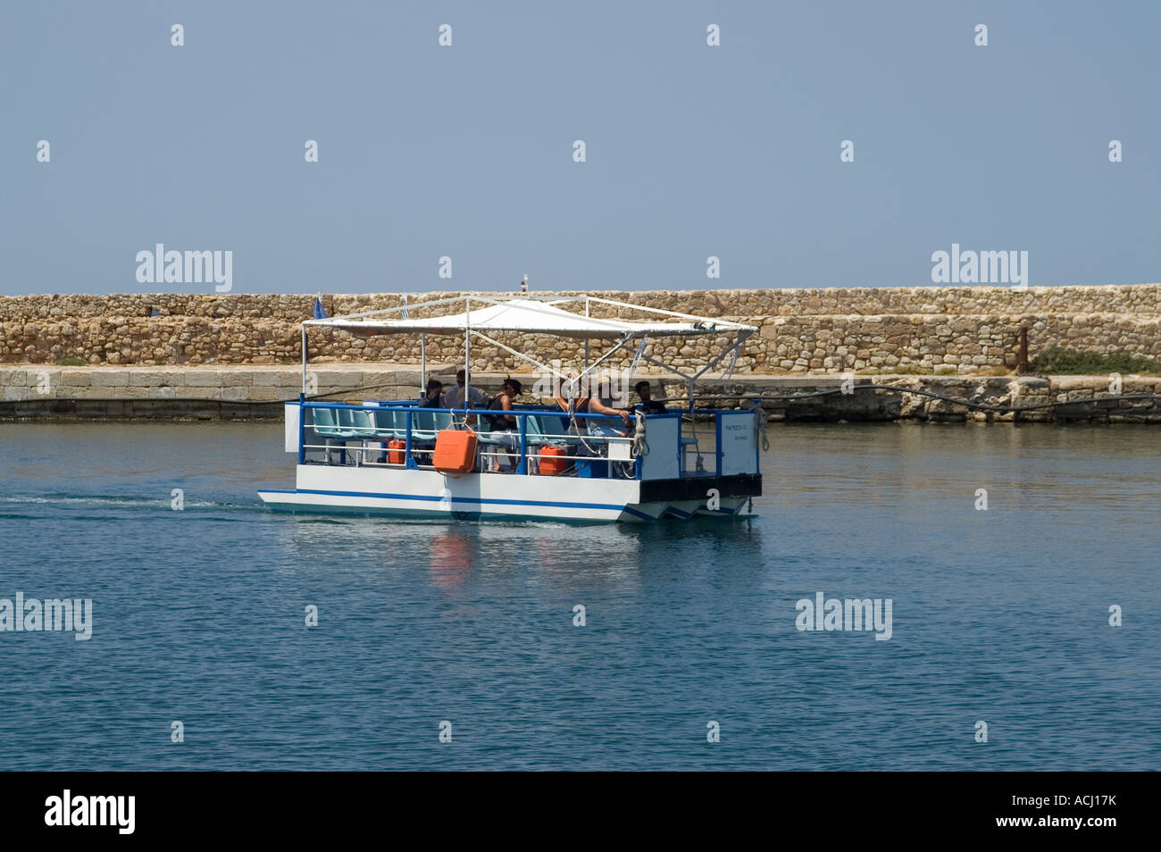 Passenger ferry crossing the harbour at Chania - Stock Image