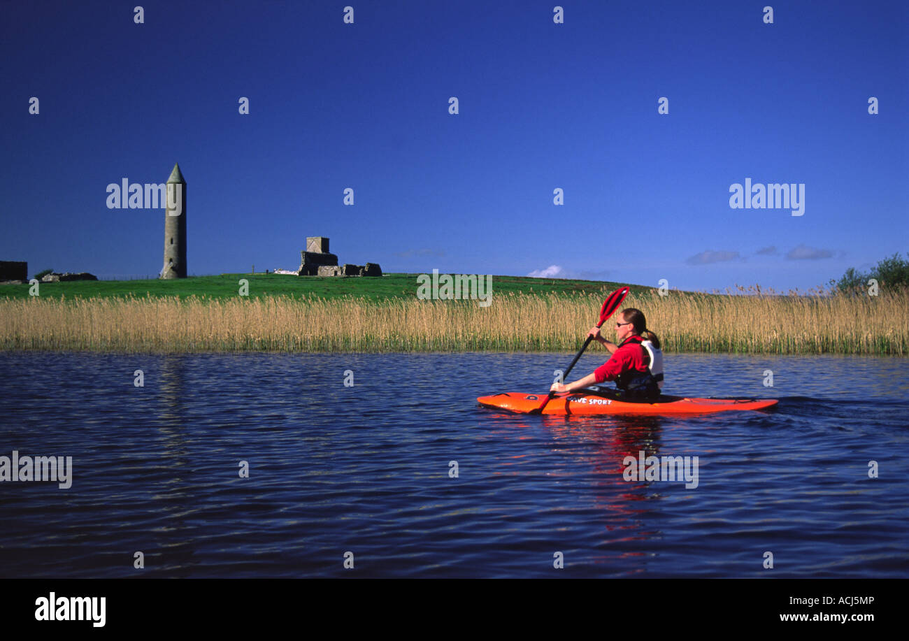 Kayaking in front of Devenish Island, Lough Erne, Co Fermanagh, Northern Ireland. - Stock Image