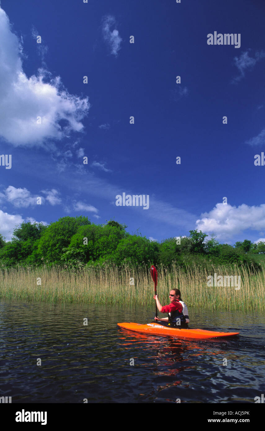 Summer kayaking on Lower Lough Erne. County Fermanagh, Northern Ireland, UK. - Stock Image